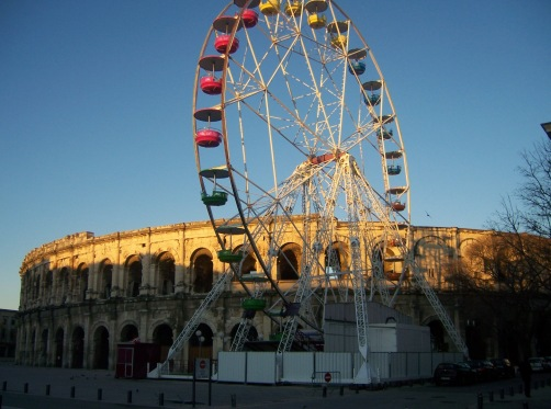 The day I met France. I arrived at Nimes on an overnight bus and watched the sunrise at the colosseum.